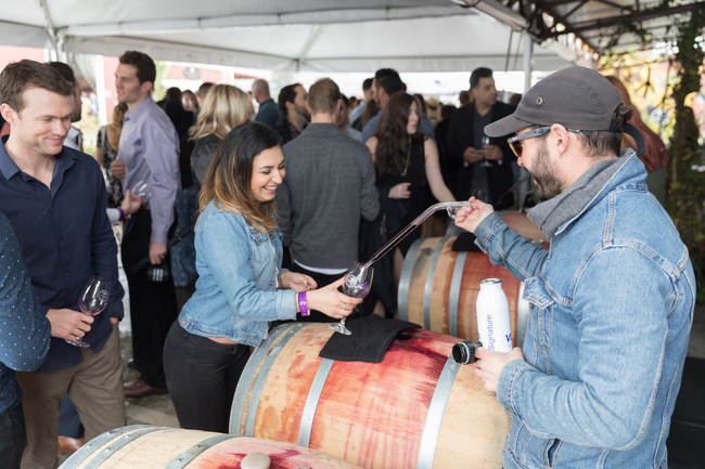 Visitors enjoying a taste directly from the Barrel.