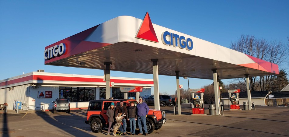 Ultimate Road Trip Sweepstakes grand prize winners, Angela and Scott Braun and their dog, with Northside Plaza CITGO owners Dean and Paula Styczynski at the Northside Plaza CITGO, 285 N Main Street in Clintonville, Wisconsin.