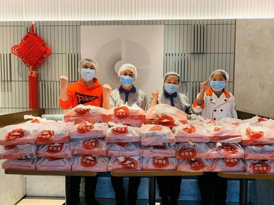 Staff volunteers preparing food donated to support medical workers in Wuhan