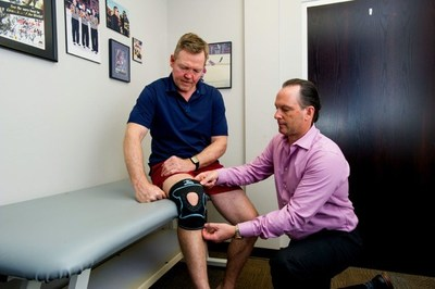 Former Montreal Canadien and NHL champion Gary Leeman is fitted with a knee brace by Trainers Choice founder and president Rick Schaly (right), in Barrie, ON, Monday, February 10, 2020. The company announced its partnership with Jean Coutu to bring the Trainers Choice line of braces and supports to Quebec's largest drug retailer. It will support the chain with education tools, active recovery products and sports medicine expertise.  The Canadian Press Images PHOTO/Trainers Choice (CNW Group/Trainer's Choice)
