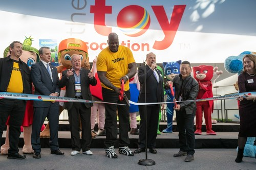 Shaquille O'Neal and toy photographer Mitchel Wu cut the ribbon to open the 117th Toy Fair New York. They were joined on stage by (left-to-right) Basic Fun! CEO Jay Foreman; Skip Kodak, executive vice-president of the Americas at LEGO Systems; Bob Wann, chief playmonster at PlayMonster; and The Toy Association's president & CEO Steve Pasierb and Marian Bossard, executive vice president of global market events.