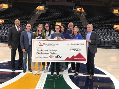 Mountain America presents a $5,000 check to The Adoption Exchange at the February 22, 2020, Utah Jazz game.
