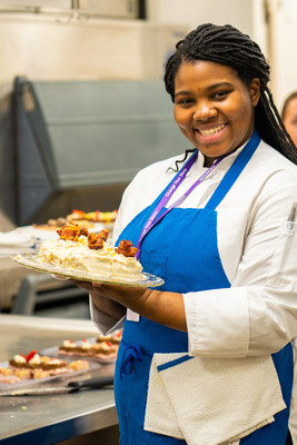 A Learn4Life student proudly displays the baking project she created in the Culinary Arts CTE Pathway course.