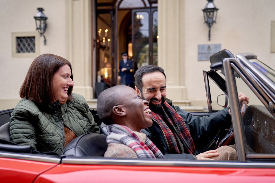 Travel influencer Jessica Nabongo and Four Seasons Magazine Editor in Chief Alicia Miller Corbett enjoy a vintage car ride with Michelin Starred Chef Vito Mollica.
