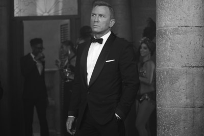 PHOTO CREDIT: B25_36559_bw_RC2James Bond (Daniel Craig) inNO TIME TO DIE,an EON Productions and Metro Goldwyn Mayer Studios film Credit: Nicola Dove© 2020 DANJAQ, LLC AND MGM. ALL RIGHTS RESERVED.PRODUCT DETAILS: TOM FORD Black Wool Atticus Shawl Collar Cocktail Jacket with Quilted Satin Lapel and Cuffs, Atticus Evening Trouser, White Poplin Collared Shirt, Black Satin Self Bowtie, Black Satin Cummerbund and Off White Silk Pocket Square