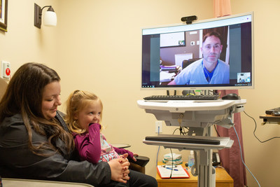 Michelle Coughlin and her daughter, Ava, are seen by Dr. Gregg Meikle, a Maple Emergency Room Physician, as part of the new ED Decanting program at Western Hospital in Alberton, PEI. (CNW Group/Maple.)