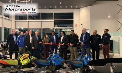 Dealer Principal Frank Serpa (r.) and Stefano Serpa (l.), Vice President, cut the ribbon marking the launch of the new Serpa Motorsports Suzuki and Yamaha dealership in Aurora, Ont. (CNW Group/Serpa Automobile Group)