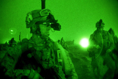 U.S. Soldiers prepare for a nighttime mission in response to an enemy rocket and mortar attack at an undisclosed Coalition and Afghan base in Afghanistan. (DoD Photo/Undated).
