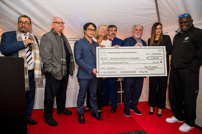 NRIA's check presentation to Goryeb Children's Hospital at the Grand Opening of Afton of Morris in Florham Park, NJ.  Left to right:  Nicholas Salzano, Rey Grabato, Bonnie Gannon, Glenn LaMattina, Rich Stabile, Nargis Fakhri and Lawrence Taylor.