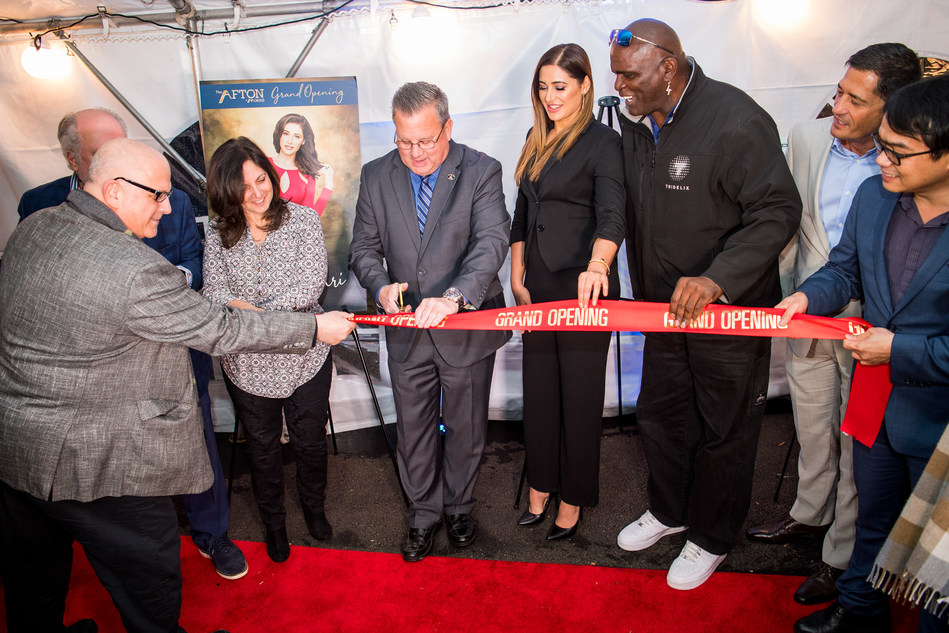 Florham Park, NJ's Mayor Mark Taylor cuts the ribbon to officially open NRIA's luxury townhome community Afton of Morris.  Mayor Taylor is assisted by American actress and model Nargis Fakhri (to his right) and NFL legend Lawrence Taylor (right of Fakhri).