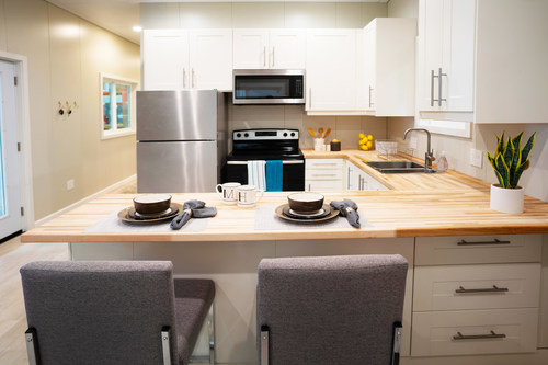McCain Homes' 500 Series Model, is a 490-square-foot accessory dwelling units with a living and kitchen area, a bathroom with a shower and space for a washer/dryer unit, and a bedroom that fits a queen-size bed.