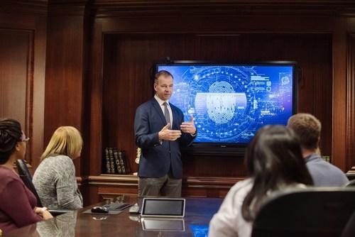 Tom Mikkelsen, M.D., medical director of the Precision Medicine Program at Henry Ford Health System, discusses Precision Medicine with staff of the Henry Ford Cancer Institute.