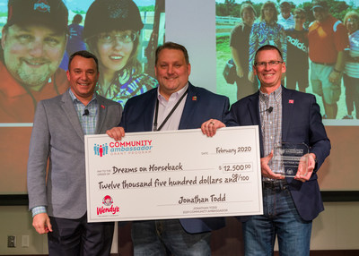 Wendy's 2019 Community Ambassador of the Year, Jonathan Todd (center), with Chief People Officer Coley O'Brien (left) and President & CEO Todd Penegor (right).