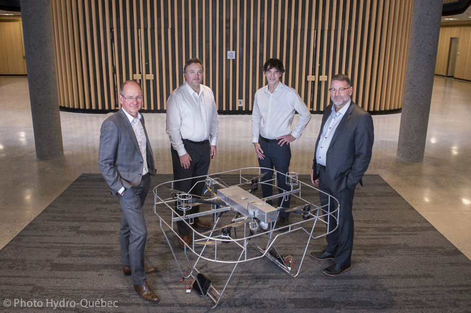 From left to right: Christian Bélanger, Director Strategic and Transversal Projects of Hydro-Québec's Research Institute, Olivier Gualdoni, Executive Chairman & CEO at DRONE VOLT, Martin Laporte, CEO of DRONE VOLT Canada, and Jean Matte, Senior Director of Hydro-Québec's research institute. (CNW Group/Hydro-Québec)
