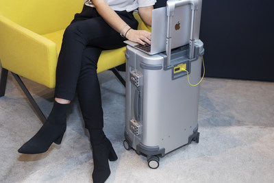 Doubling as a desk, Samsara's suitcase allows travelers to avoid public work spaces. (PRNewsfoto/Samsara Luggage Inc)