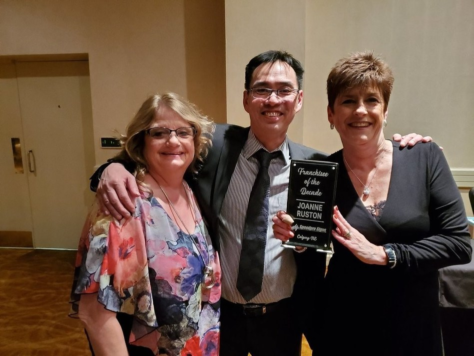 Jeannette Marks, Office Manager, Joe Yee, Production Manager and Joanne Ruston, Owner, of Speedpro Signs North Calgary celebrate being awarded Speedpro Franchise of the Decade at the 2020 SpeedPro National Conference. (CNW Group/Speedpro Signs North Calgary)