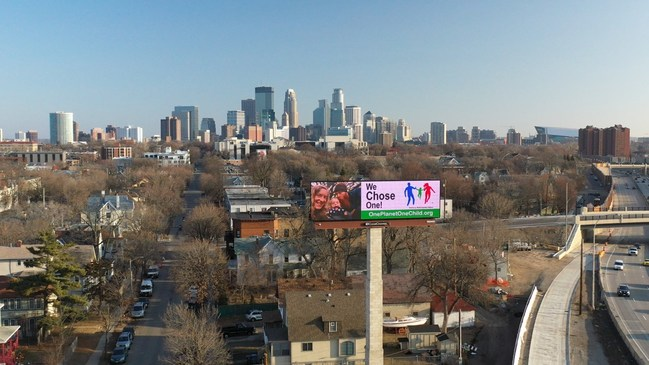 One Planet, One Child billboard adorns the Minneapolis skyline