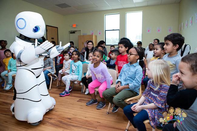 Early childhood kids enjoying first robotic education