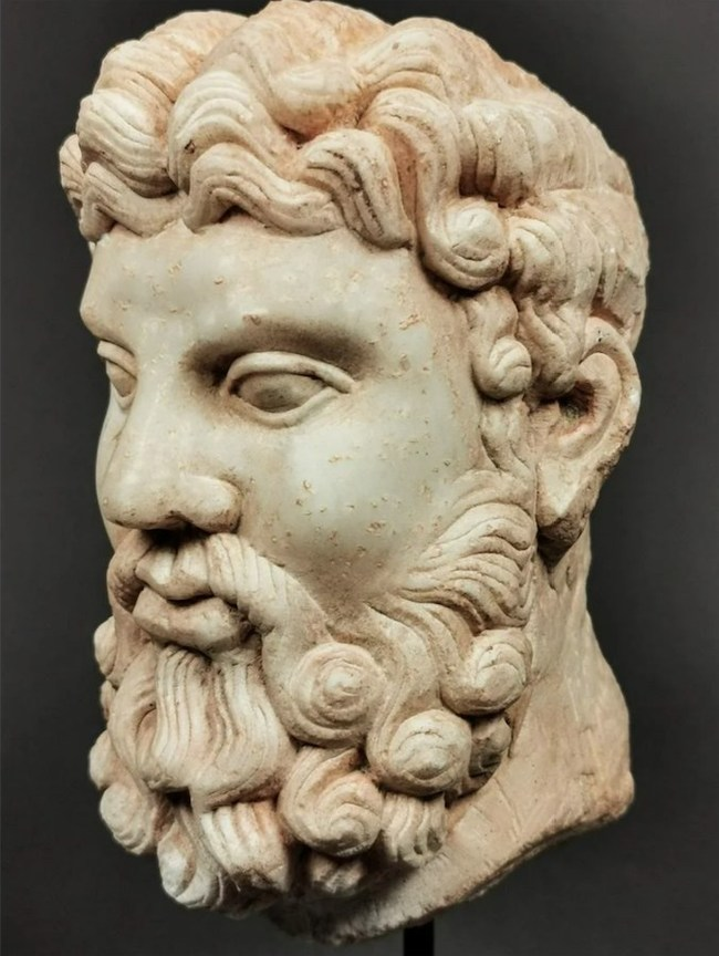 Roman marble head of Hercules, perhaps based on a Greek 4th century BC prototype by Lysippos, very fine condition, 245 x 85mm (with stand). Estimate $£6,000-£12,000 ($7,360-$14,730)