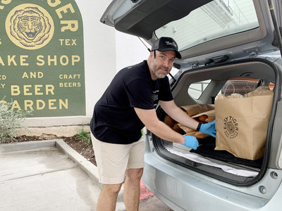 Easy Tiger CEO Mike Stitt loads bread for delivery as a part of the ongoing community partnership.