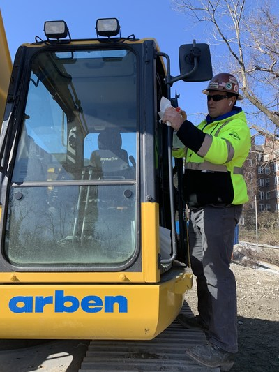 An operator disinfects a cab before use.