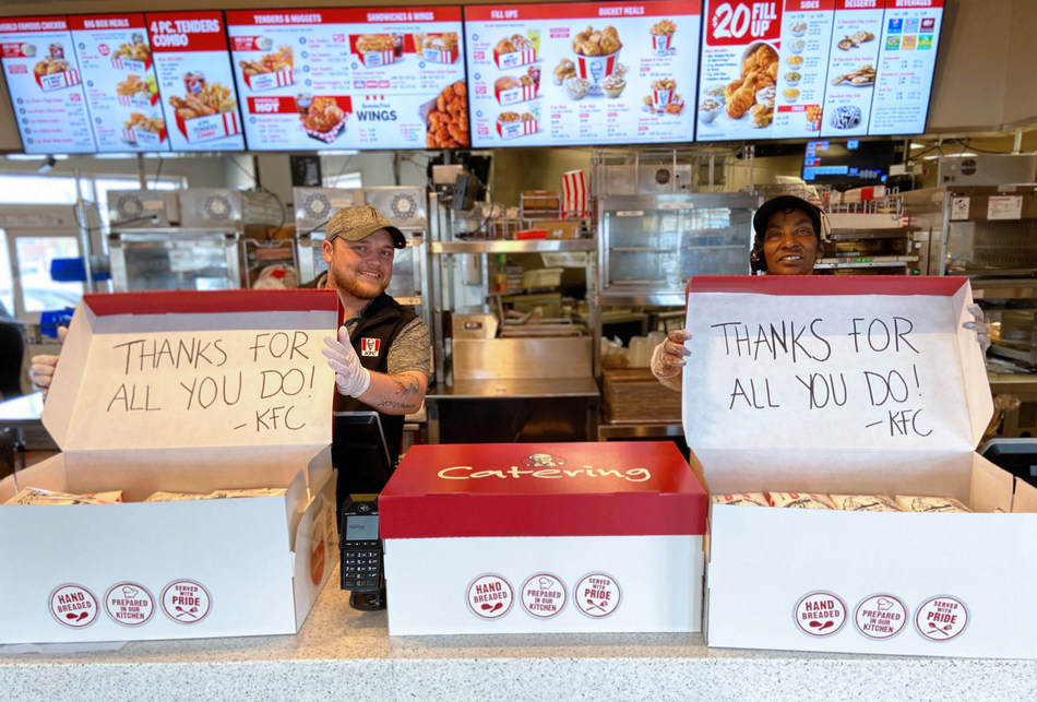 KFC restaurant team members in Louisville, Ky., pack up more than one hundred meals to deliver to local hospital workers fighting the COVID-19 pandemic.