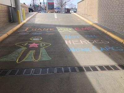 Inspirational chalk art message outside Children's Minnesota St. Paul hospital during COVID-19 pandemic.