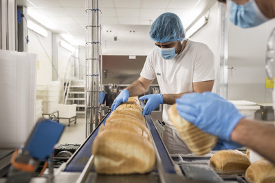 Dr. Schar employees securing the production of gluten free bread. (PRNewsfoto/Dr. Schar)