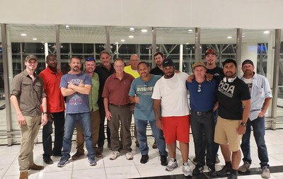 M.C. Dean employees and contractors who returned to the United States yesterday.