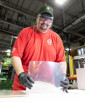 Jerry Miller, an assembler at John Deere Seeding Moline, assembles protective face shields for health-care workers as part of a partnership between the UAW and John Deere to provide the face shields to health-care workers in 17 of Deere's US manufacturing communities.