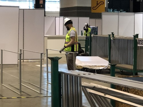 Union carpenters work on building patient rooms at McCormick Place in Chicago.