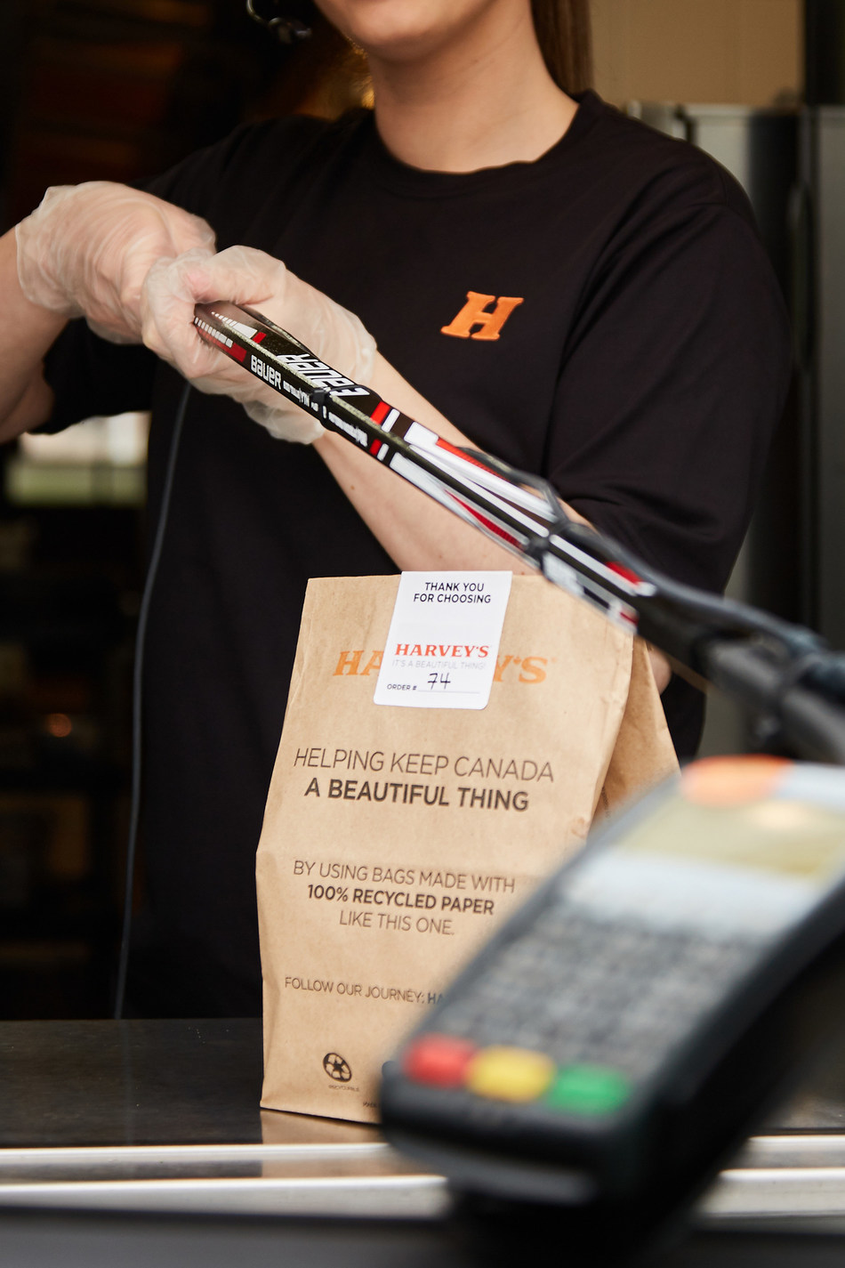 Harvey's and Bauer Hockey team up to keep Canadians apart and help feed those in need (CNW Group/Harvey''s)