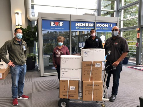 IEHP's Business Continuity Director Philip Lo, Senior Facilities Coordinator Christopher Aguas and Facilities Coordinator Marquis Wilson present 7,500 surgical masks to SBCMS's Membership Director Soteria Cobb.
