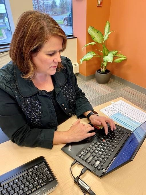 Dr. Suzanne Morgan of Paladina Health's Akron (OH) direct primary care clinic consults with a patient virtually via teleconferencing.