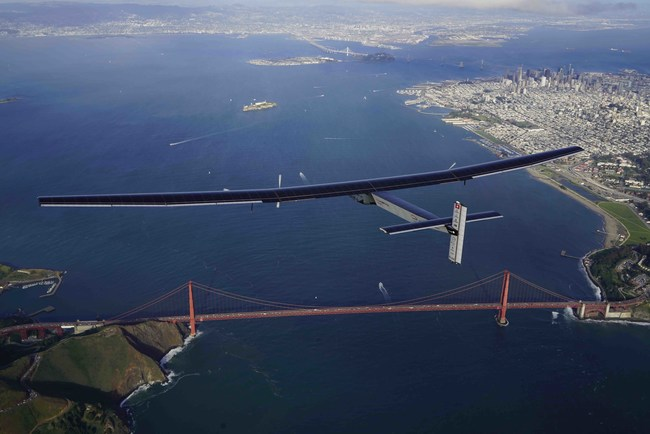 """Bertrand Piccard flies over the Golden Gate Bridge in Solar Impulse, powered only by the rays of the sun. The 25,000-mile flight around the world did not use a single drop of fossil fuel.This photo was taken the day after Earth Day 2016. """"Clean technologies are ready to use NOW. Let's move the economy in that direction,"""" says Piccard."""