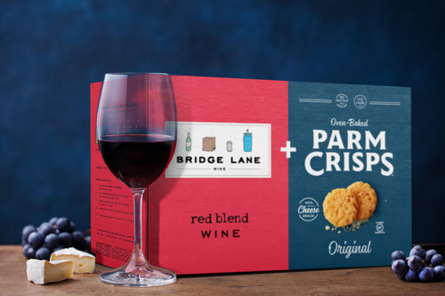 The Limited-Edition premium Wine & Cheese Box pairs Bridge Lane Red Blend with ParmCrisps Original oven-baked 100% aged parmesan cheese crisps for the ultimate wine and cheese night in.