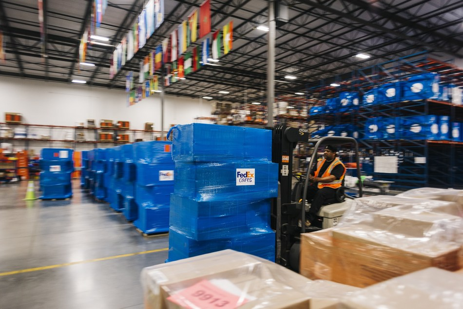 Pallets of surgical masks, donated by AstraZeneca, are prepared at Direct Relief's global distribution facility in California for delivery via FedEx to health workers battling Covid-19 across the United States. (Photo: Direct Relief)