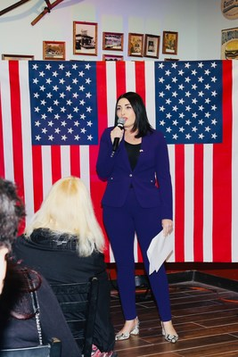 Candidate Laura Loomer speaking at an event in Palm Beach, Florida.