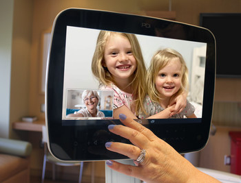 Patient using Nautilus Medical's TeleRay on a PDI Communications MedTab TV for communicating with family and healthcare professionals while in a senior living facility or healthcare institution. Keeping patients safe and connected.