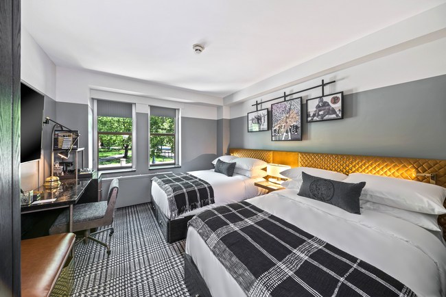This double room features two full-sized beds, plus all the essentials.  Outfitted with Purdue plaid, custom artwork and even Purdue-Crested Bed Pillows. Perfect for the traveling pair or family during a campus visit. (PRNewsfoto/White Lodging)