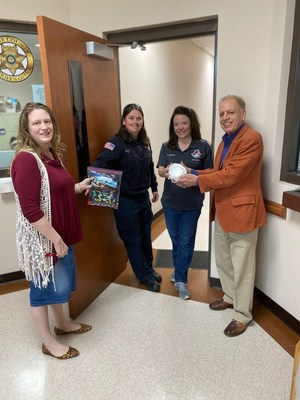 Dr. John Staley & Sonya Gunther delivering PPE to Roane County Sheriff's Department.