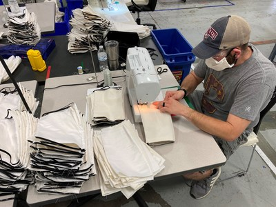 An employee at Tempur Sealy's Medina, Ohio plant sews face masks. TSI plants across the country and around the world are manufacturing products for the COVID-19 relief effort. Many of the face masks are being donated to charity.