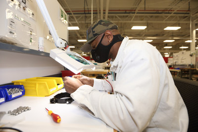 A Honda associate carefully reviews his work assembling a Dynaflo compressor at the Technical Development Center in Marysville, Ohio.