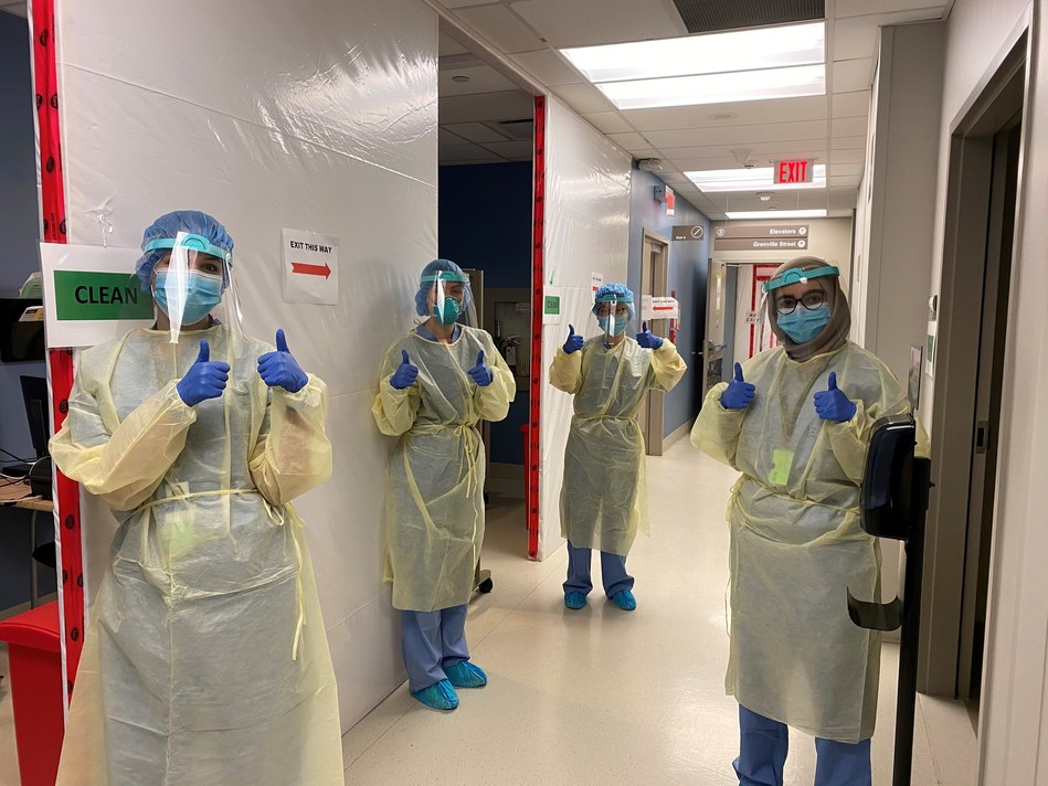 Women's College Hospital Assessment Centre and Screening staff wearing Spin Master face shields. (CNW Group/Spin Master)