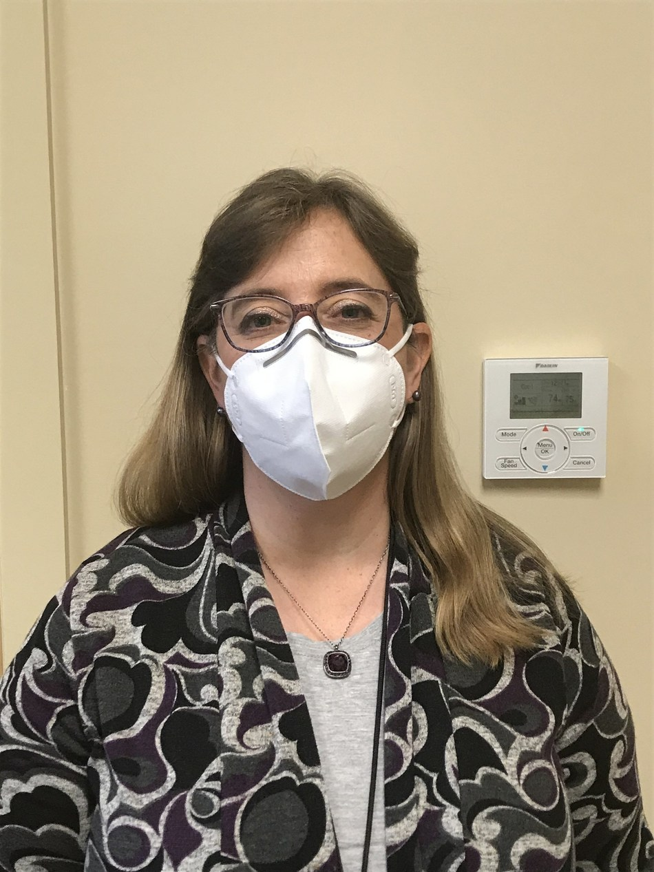 Photo is of Lisa Ellis, Director of Nursing, Community Health Connections, wearing one of Massive Technologies KN95/FFP2 masks from PGT in Fujian, China.