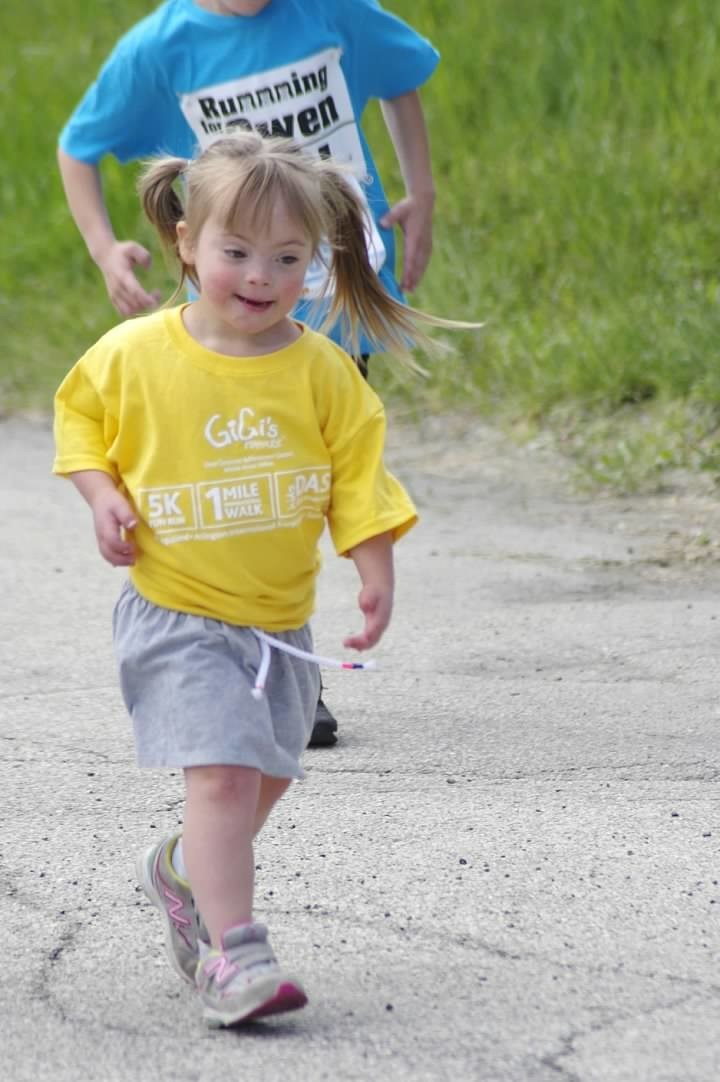 Emma Silverman, age five, participating in GiGi's Playhouse 5k Run and Dash for Down Syndrome at Arlington Park Race Track in 2019.