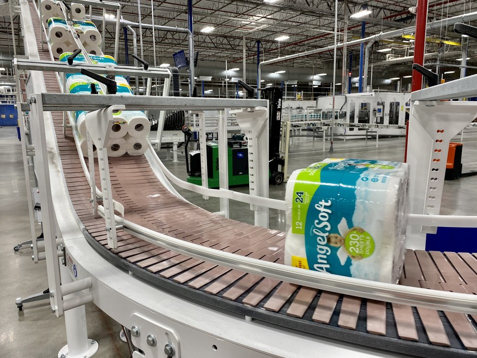 Packages of Angel Soft® bath tissue roll along the production line at a Georgia-Pacific plant in Florida in late March. The company has employees working around the clock to help fill empty store shelves.