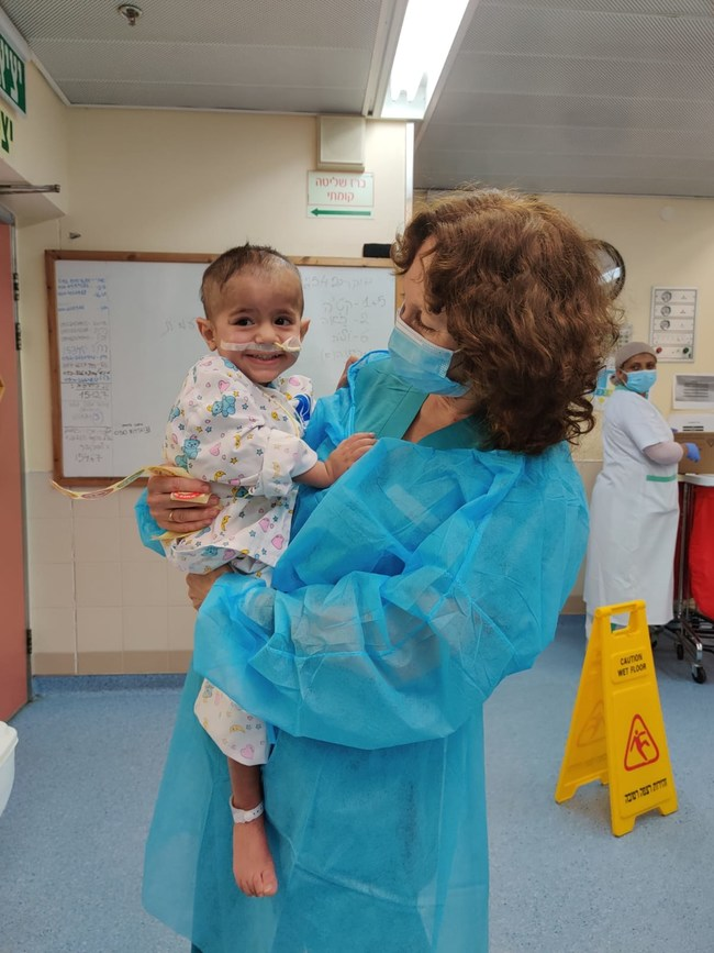 Palestinian child, Hamza, and one of the nurses taking care of him.