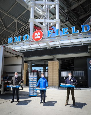 "(Left to right) Michael Friisdahl, President and CEO, MLSE, Darryl White, CEO, BMO Financial Group and Mayor John Tory visit BMO Field to kick-off expansion of MLSE's ""Bringing Toronto Back To Its Feet"" program. (CNW Group/BMO Financial Group)"