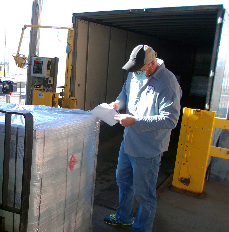 An Arkema employee prepares hand sanitizer solution for shipment from its Geneseo, N.Y. plant to State agencies, to aid in the fight against COVID-19 (photo provided by Arkema Inc.)